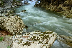 Rushing water in among the rocky walls Stock Image