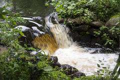 Rushing Water. This is a small water fall with the water rushing bye Stock Photo