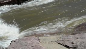 Rushing water in a stream stock video footage
