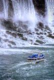 Rushing waterfalls boat tours. Rushing waterfalls at Niagara falls tourist area Stock Photos