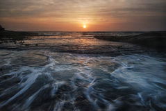Rushing waves seascape sunrise Stock Photo