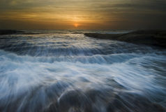 Rushing waves seascape sunrise Stock Images