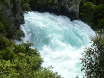 The rushing wild stream of Huka Falls near Lake Taupo, New Zealand. royalty free stock photo