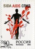 RUSIA - 1993: ¡la parada de las demostraciones AYUDA! La figura de un hombre en una composición colorida Imagen de archivo libre de regalías