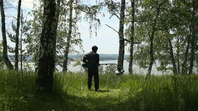 Rusia, Siberia 2014: Hierba de siega del hombre cortacéspedes almacen de video