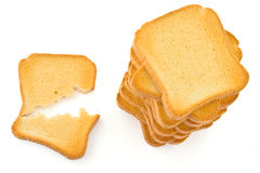 Rusk. Above view of a broken rusk and a pile of rusk; isolated on white background Stock Image