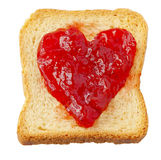 Rusk. With strawberry jam in shape of heart Stock Image