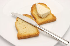 Rusk bread slice, cheese and knife Stock Images