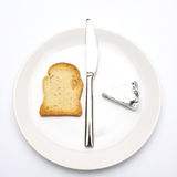 Rusk bread slice, cheese and knife Stock Photo