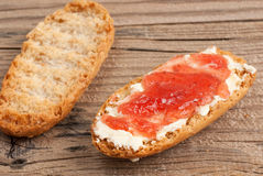 Rusk with butter and jam Stock Images