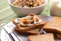 Rusk with cream and granola Royalty Free Stock Image