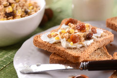 Rusk with cream and granola Royalty Free Stock Photo