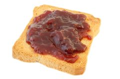 Rusk and jam. Macro of golden rusk and raspberry jam Royalty Free Stock Images