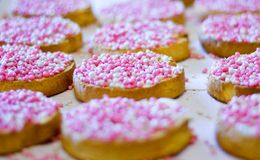 Rusk with mice. Rusks with candy-coated aniseed in pink-and-white to celebrate the birth of a baby girl (Dutch treat Royalty Free Stock Photos