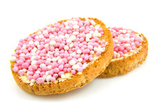 Rusk with pink mice. To celebrate the birth of a daughter, over white background Stock Image