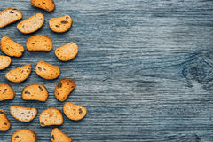 Rusk with raisins on a wooden blue background stock photos