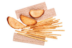 Rusk and salted breadsticks isolated Stock Images