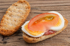 Rusk sandwich with salami, egg and tomato Royalty Free Stock Photography