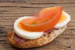 Rusk sandwich with salami, egg and tomato Royalty Free Stock Image