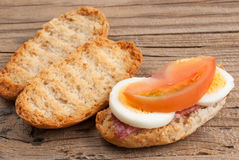 Rusk sandwich with salami, egg and tomato Royalty Free Stock Images