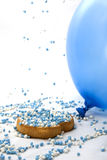 Rusk sprinkled with mice. Rusk sprinkled with blue mice on a white background Royalty Free Stock Photos