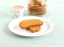 Rusk and Tea. Rusk, a popular, crunchy and crispy biscuit, and tea, on a plate Royalty Free Stock Photography
