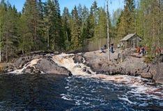 Ruskeala, Karelia, Russia. Ahvenkoski Waterfall. RUSKEALA, KARELIA, RUSSIA - MAY 14, 2016: Excursion group near Ahvenkoski Waterfall on Tohmajoki River. It is royalty free stock photo