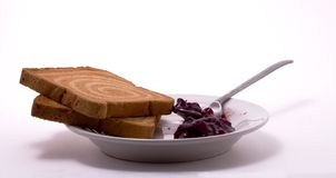 Rusks, coffee spoon and jam Royalty Free Stock Images