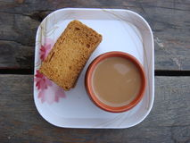 Rusks and kullad tea in plate. Homemade tea with tasty rusks stock photos