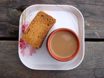 Rusks and kullad tea in plate. Tasty rusks and kullad tea in plate stock images