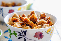 Rusks in a light cup. Pieces of rusks in a light cup on the table Royalty Free Stock Photography