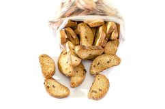Rusks with raisins on a white background. Big pile. stock photo