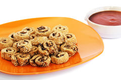 Rusks with sesame seeds, olives and sauce stock photo