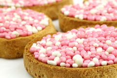 Rusks with white and pink anise seed sprinkles Stock Photos