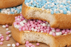 Rusks with white, pink and blue anise seed sprinkles Stock Photography