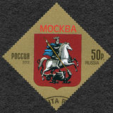 RUSLAND - 2012: toont Wapenschild van Moskou, Russische Federatie Stock Afbeelding