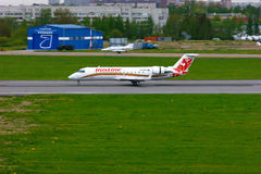 Rusline Airlines Bombardier Canadair Regional Jet CRJ-200 aircraft in Pulkovo International airport in Saint-Petersburg, Russia Royalty Free Stock Photo