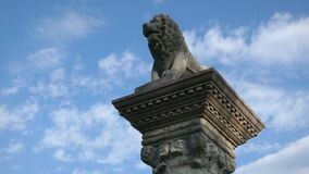 Rusovce, Slovakia - CIRCA MAY 2021, Old stone pillar with lion statue on top, low angle