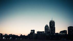 Ruspe spianatrici del cielo della città di Boston nell'inverno fotografie stock