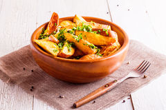 Rusric style potatoes served with parsley and garlic Royalty Free Stock Image