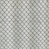 Rusry metal grid on the background of gray slate. Royalty Free Stock Images