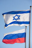 Russain Israel flags together symbol of friendship of two countr Stock Photo