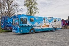 Russ bus or Russebuss in city of Halden, Norway - Aqua theme royalty free stock photos