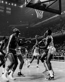 Russell and Chamberlain battle for a rebound. Boston Celtics center Bill Russell and Philadelphia center Wilt Chamberlain position to get a rebound.  (Image Royalty Free Stock Images