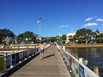 A young man walking along the dock entering the beautiful tourist town of Russell royalty free stock photos