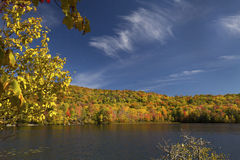 Russell Pond in New Hampshire with deep blue sky, autumn. Royalty Free Stock Photo