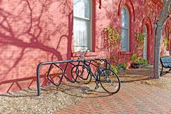 Free Russet Orange Brick Sidewalk, Red Pear Painted Building, And Bike Make An Autumn Scene Stock Photo - 129694460