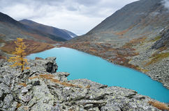 Russia, The Altai mountains, lake Acchan Akchan in september in cloudy weather Royalty Free Stock Photos