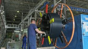 Russia, Angarsk - June 8, 2018: Roll threading coil pipe. Manufacture of plastic water pipes factory. Process of making. Russia, Angarsk - June 8, 2018: Roll stock video