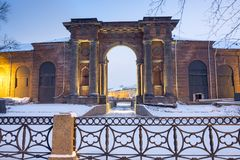 Russia. Arch of the brick building of New Holland in St. Petersburg on the bank of the Moika River on a winter evening. Arch of the brick building of New Holland royalty free stock image